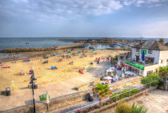 Lyme Regis Dorset uk coast people enjoy the late summer sunshine Stock Photography