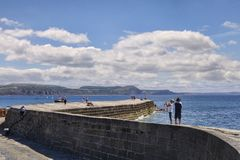 Lyme Regis Dorset UK The Cobb and Tourists Royalty Free Stock Photos