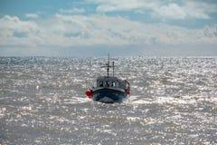 LYME REGIS, DORSET/UK - 22. MÄRZ: Fischen-Ruderwettkampf-Haus zu L Stockfotografie
