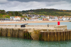Lyme Regis England. Lyme Regis in Dorset, England, situated in Lyme Bay, in the English Channel on the  Dorset–Devon border.  Famous for fossils and being part Stock Photos