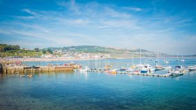 Lyme Regis harbor with boats in Dorset, UK stock images