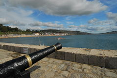 Lyme Regis Harbour Cannon Stock Image