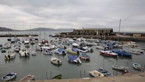 Lyme Regis harbour Dorset England UK with boats moored stock video