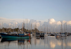 Lymington. Reflections of clouds at Lymington Quay Stock Image