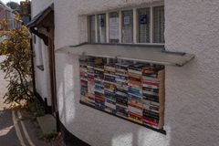 Lympstone, Devon, UK, April, 8, 2019: A pile of books for sale on a window sill in a village in Devon, all money raised royalty free stock photos