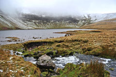 Lyn y fan fach lake in the winter, incoming stream of bubbling pure natural water, Brecon Beacons national park, Wales Royalty Free Stock Images