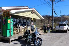 Lynchburg BBQ. The outside of a southern American barbecue shack restaurant with bikers and motorcycle in Lynchburg, Tennessee royalty free stock image