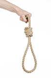 Lynching and suicide theme: man's hand holding a loop of rope for hanging on white isolated background Stock Photography