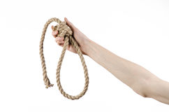 Lynching and suicide theme: man's hand holding a loop of rope for hanging on white isolated background Royalty Free Stock Photos