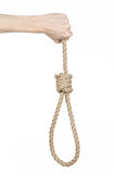 Lynching and suicide theme: man's hand holding a loop of rope for hanging on white isolated background Stock Images