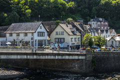 Lynmouth. The bridge across the river across the West lyn. Lynmouth, Devon, England, 13 July 2016: The bridge across the river across the West lyn. People walk royalty free stock photography