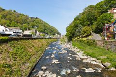Lynmouth Devon England UK river running through the town. Beautiful spring sunshine royalty free stock photography