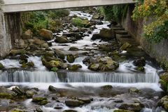 Lynmouth in Devon. Long exposure of the river flowing under the bridge in Lynmouth in Devon royalty free stock photography