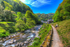 Lynmouth Devon River Lyn start of walk to Watersmeet looking back towards town in colourful hdr Stock Photos