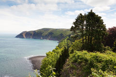 Lynmouth with Foreland Point  North Devon England. Lynmouth with Foreland Point viewed from the hillside over looking the bay  North Devon England Royalty Free Stock Photos