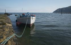 Lynmouth Harbour. A small boat in the Harbour of Lynmouth, Exmoor National Park to transport tourists to the Valley of Rocks for sightseeing royalty free stock image