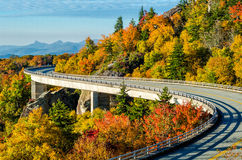 Lynn Cove Viaduct, Blue Ridge Parkway. Autumn at the Lynn Cove Viaduct along the Blue Ridge Parkway in North Carolina. Hawksbill and Table Rock Mountains can be Royalty Free Stock Images