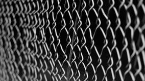 Lynnigt skott av ett staket i m?rkret royaltyfria foton