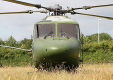 Lynx Helicopter. A Westland Lynx helicopter nestled in a field of crops royalty free stock images
