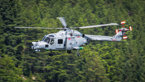 Lynx helicopter. A Royal Navy Lynx helicopter conducting a low level sortie through a Welsh valley, United Kingdom. 23rd June 2015 stock photos