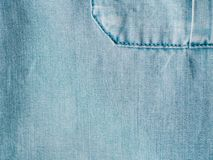 Lyocell or tencel blue denim pattern texture. Modern soft jeans blouse with breast pocket texture close up. Lyocell or tencel pattern - modern natural cellulose stock photos