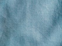 Lyocell or tencel blue denim pattern texture. Modern soft jeans blouse texture close up. Lyocell or tencel pattern - modern natural cellulose fabric blue denim royalty free stock images