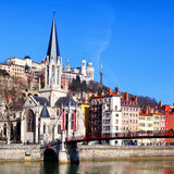 Lyon cityscape from Saone river with footbridge Royalty Free Stock Photo