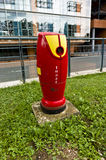 Lyon Fire Hydrant. Modern looking red fire hydrant in the city of Lyon, France Royalty Free Stock Image