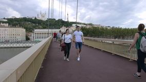 Lyon footbridge an tourists in the french city stock video
