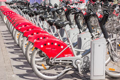 LYON, FRANCE - on APRIL 14, 2015 - Shared bikes are lined up in the streets of Lyons, France. Velo'v Grand Lyon has over 340 stati Royalty Free Stock Images