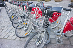 LYON, FRANCE - on APRIL 15, 2015 - Shared bikes are lined up in the streets of Lyons, France. Velo'v Grand Lyon has over 340 stati. Ons and 3000 bikes throughout Stock Photography