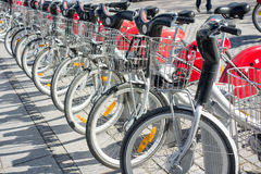LYON, FRANCE - on APRIL 15, 2015 - Shared bikes are lined up in the streets of Lyons, France. Velo'v Grand Lyon has over 340 stati. LYON, FRANCE - on APRIL 15 Royalty Free Stock Photography