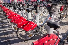 LYON, FRANCE - on APRIL 15, 2015 - Shared bikes are lined up in the streets of Lyons, France. Velo`v Grand Lyon has over 340 stati. Ons and 3000 bikes throughout Royalty Free Stock Images