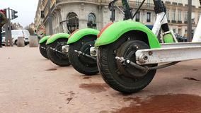 Four Electric Rental Scooter Lime-S Place Bellecour Lyon France. Lyon, France - January 4, 2019: Four Lime-S Electric Rental Scooter Parked On Place Bellecour In stock video footage