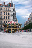 LYON, FRANCE - JULY 21, 2010: View to the carousel and fountain Stock Photos