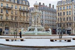 Place des Jacobins under the snow. LYON, FRANCE, March 1, 2018 : Fountain of Place des Jacobins, as a cold spell rages in all Europe and the Capital of Gallia is Stock Image