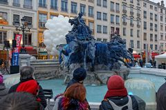 Waiting for the inauguration of the fountain. LYON, FRANCE, March 22, 2018 : Inauguration of the renovated Bartholdi fountain on Place des Terreaux after two Stock Photo