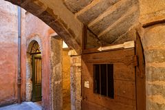 Doors under the stairs of La Grande Traboule. LYON, FRANCE, March 11, 2018 : La Grande Traboule. Traboules from Latin transambulare meaning `to cross` are a type Royalty Free Stock Photos