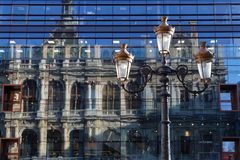 Reflection on a big store with a street lamp. LYON, FRANCE, March 19, 2018 : Reflection of the trade house of Lyon in glass facade of a big store Stock Photo