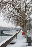 Snow on Rhone river banks in Lyon. LYON, FRANCE, March 1, 2018 : Rhone river banks as a cold spell rages in all Europe and the Capital of Gallia is under the Stock Photography