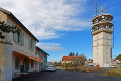 Radio tower at the Mont Cindre. LYON, FRANCE, March 10, 2018 : A tower relay sheltering in particular a radio transmitter, at the Mont Cindre in the Monts d`Or Royalty Free Stock Image