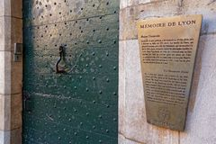Traboule information on a wall of Lyon city center. LYON, FRANCE, March 11, 2018 : Traboule information. Traboules from Latin transambulare meaning `to cross` Stock Photography