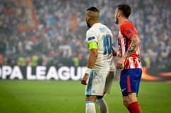 LYON, FRANCE - 16 May, 2018: Saul Niguez against Dimitri Payet. (L)during the final UEFA Europa League match between Atletico Madrid vs Olympic Marseille at the Stock Image