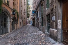 Side Street in Lyon. Lyon, France--November 6, 2017--A cobblestone side street in the old city section of Lyon. Editorial Use Only Stock Photo