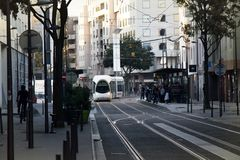 Modern eco-friendly electric public transport in city in evening. Lyon, France - October 14, 2017: modern eco-friendly electric public transport in city. Hybrid Stock Photography