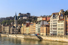Lyon, France. The quay along the river with old houses and a church in Lyon, France Stock Image