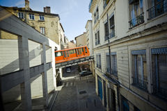 Lyon funicular. Wide angle view of the Lyon (France) funicular going through the city's buildings Royalty Free Stock Images