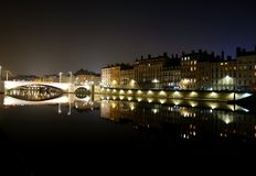 Lyon mirrored in the water during the night Stock Image