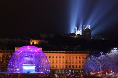 Lyon by night. Bellecour square in Lyon, during ligth fest every december, the 9th royalty free stock photo
