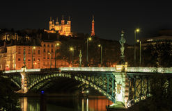 Lyon at night. Illuminated bridge 'Pont de l'Universite' and cathedral 'Notre Dame de Fourviere' in Lyon at night Stock Photography